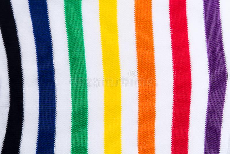 Fond texturisé d'impression de textile rayé coloré de tissu Configuration plate photos stock