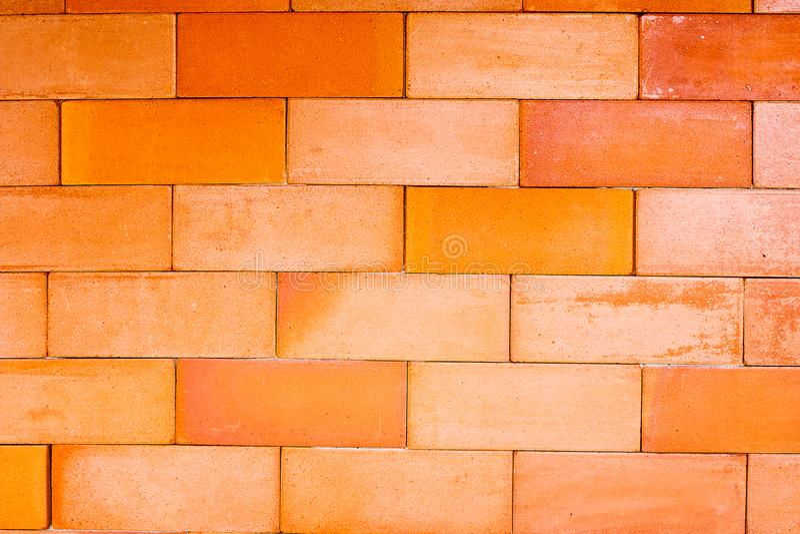 Fond texturisé de mur de briques orange vide photographie stock