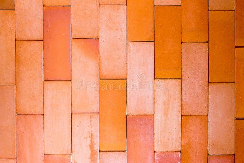 Fond texturisé de mur de briques orange vide images stock