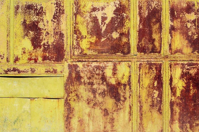 Fond texturisé de papier peint de panneau rouillé en métal photos stock