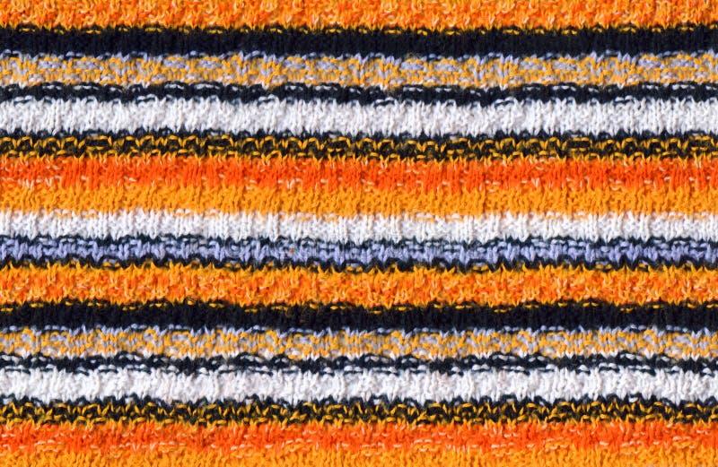 Fond tricoté rayé photos stock