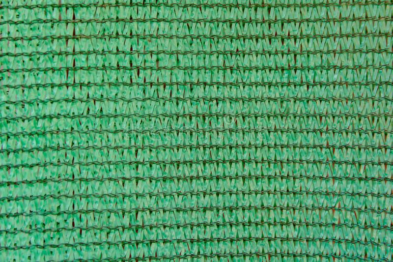 Fond vert de filet d'ombrage filet de ombrage vert de construction images stock