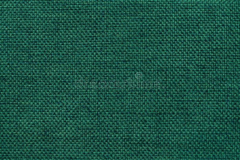 Fond vert-foncé de tissu mettant en sac tissé dense, plan rapproché Structure du macro de textile image libre de droits