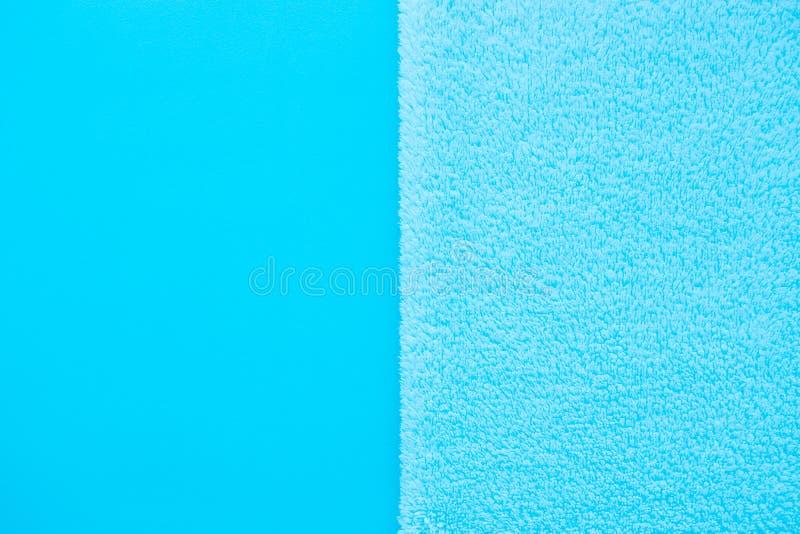Fond vertical de deux types de tissu bleu - lissez et grippe photos stock