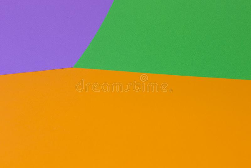 Fond violet vert orange lumineux photographie stock