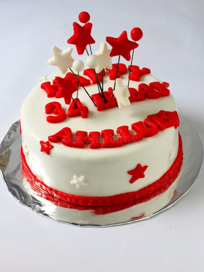 Fondant birthday cake cake. Birthday fondant cake decorated with beautiful red and white stars stock images