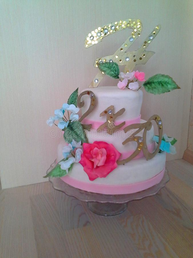 Fondant cake for birthday with sugar roses, hydrangea and topper in white, blue and pink colors stock images