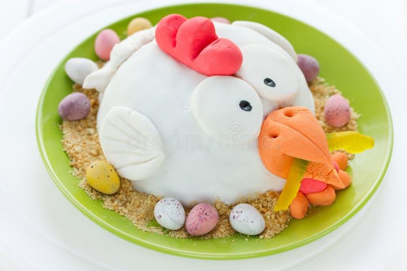 Fondant cake Easter chicken in nest. Festive fondant cake Easter chicken in nest royalty free stock photos