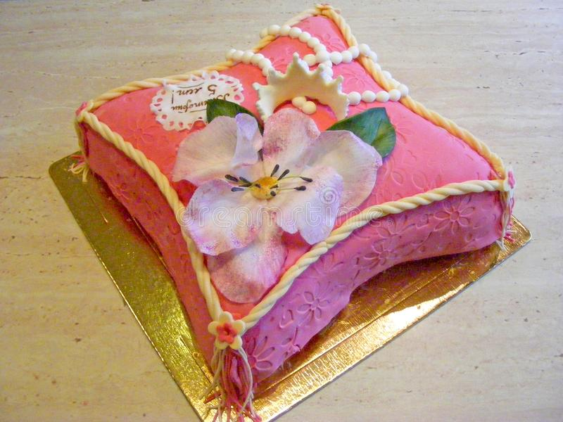 Fondant cake in form of pillow with flower for girl. 5 years old stock photo
