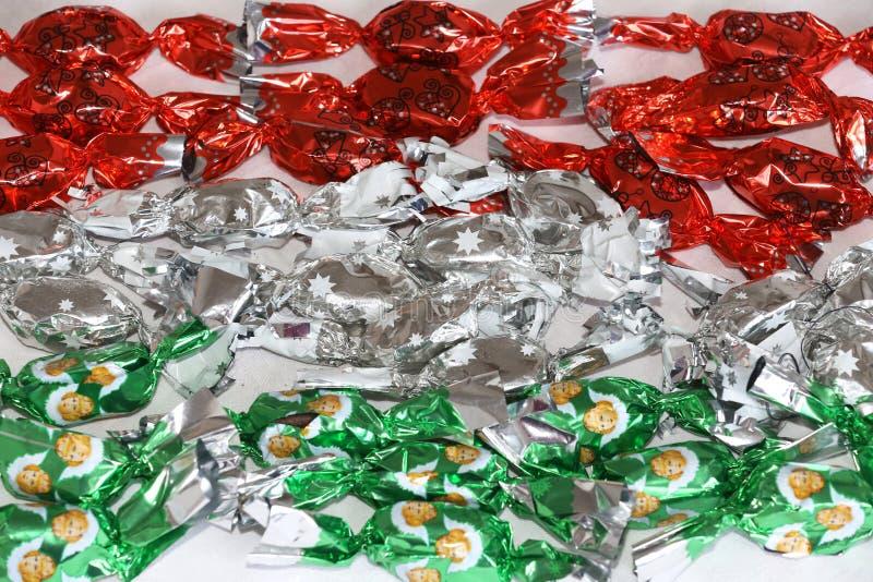 Fondente di dolcezza di Natale in metallo variopinto che si avvolge nei colori nazionali ungheresi fotografia stock