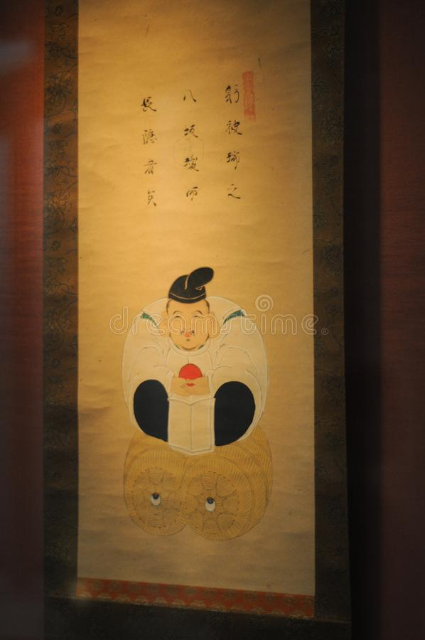 Fondi Dio Ebisu sull'opera d'arte È uno di sette dei di fortuna La cultura asiatica crede che se avere un grande orecchio, voi pu fotografia stock