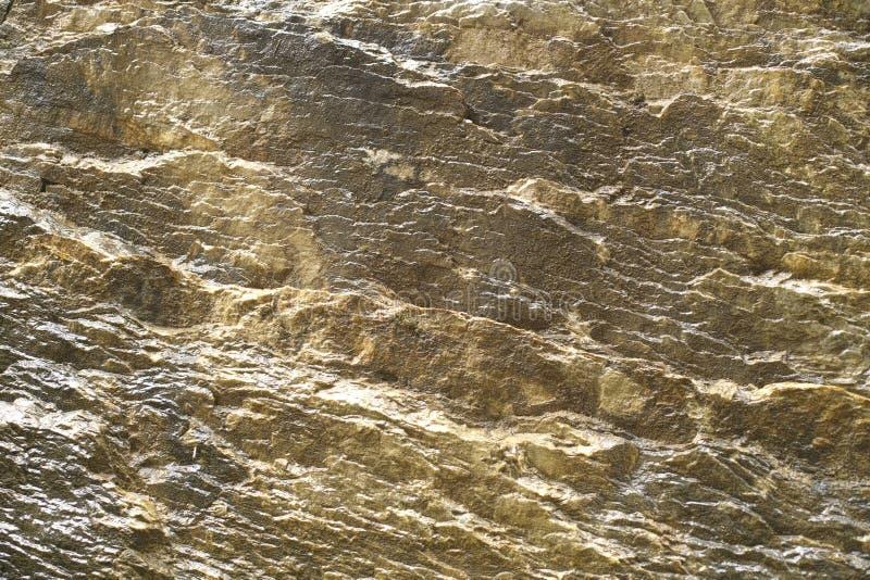 Fondo abstracto con cierre mineral de la textura de la roca del color de oro para arriba fotos de archivo libres de regalías