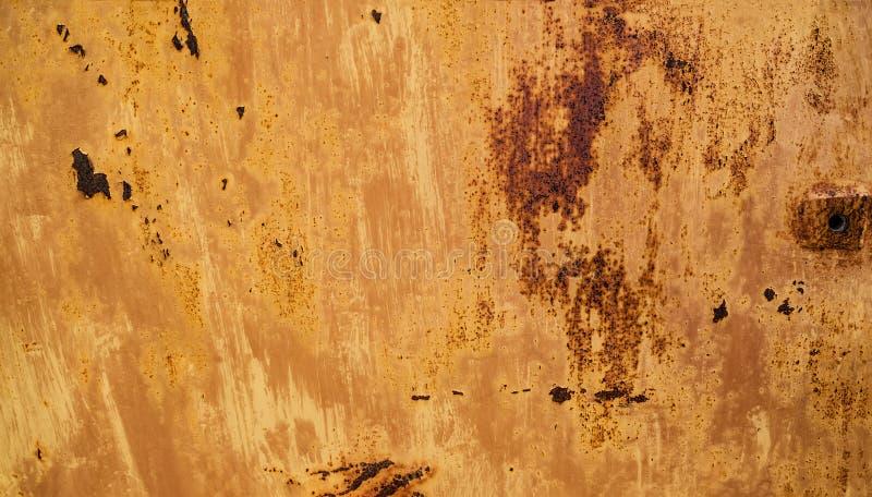 Fondo abstracto con el agujero en la derecha y la textura del anaranjado-marrón del moho coloreado con los puntos foto de archivo