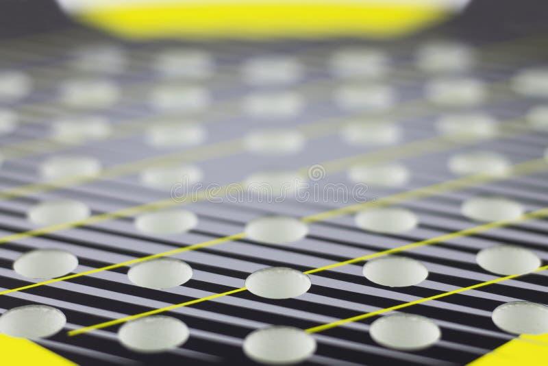 Fondo abstracto con el foco selectivo Estafas de las aberturas para jugar a tenis de la playa fotografía de archivo