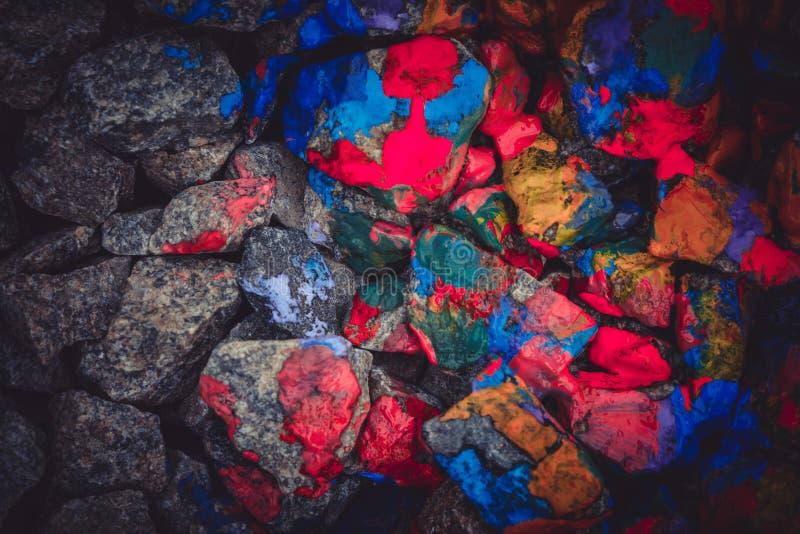 Fondo abstracto con la pintura coloreada de las piedras imagen de archivo libre de regalías