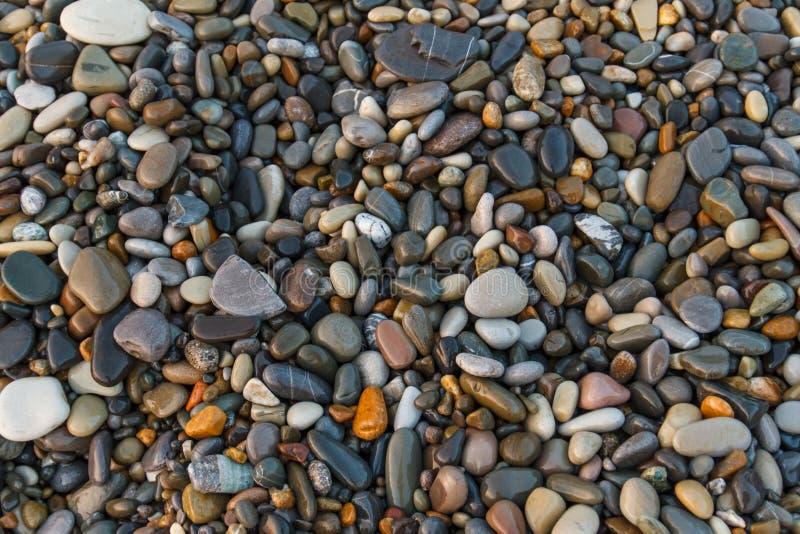 Fondo abstracto con las piedras Guijarros, fondo del extracto de la costa con las piedras imágenes de archivo libres de regalías