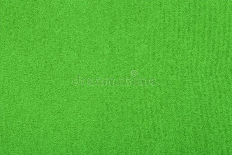 Fondo abstracto con textura verde, tela de rizo fotos de archivo