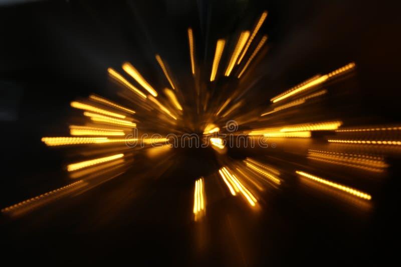 fondo abstracto de la explosión de oro de la luz hecha del movimiento del bokeh fotos de archivo