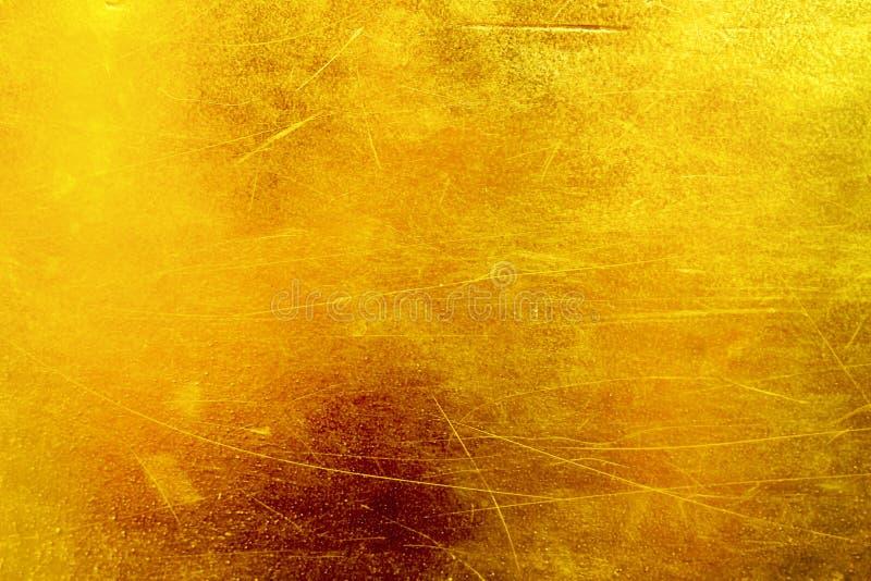 Fondo abstracto de la textura del oro con los modelos de los rasguños imagen de archivo libre de regalías