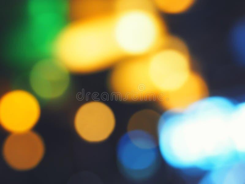 Fondo abstracto de las luces de la ciudad del bokeh, fuera de la pintura de la luz del foco fotografía de archivo