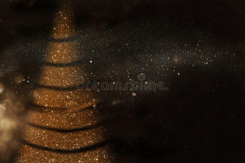 Fondo abstracto Defocused de las luces del oro y del negro fotos de archivo