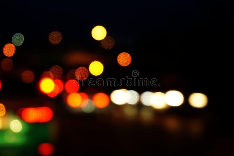 fondo abstracto defocused del bokeh colorido de la luz de la noche de la ciudad imágenes de archivo libres de regalías