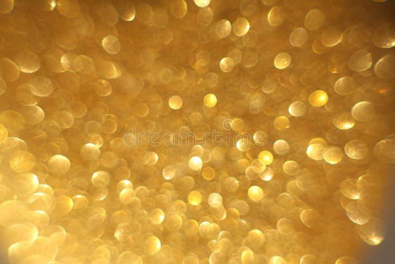 Fondo abstracto del bokeh de la Navidad de oro del brillo Contexto borroso de las chispas fotos de archivo libres de regalías