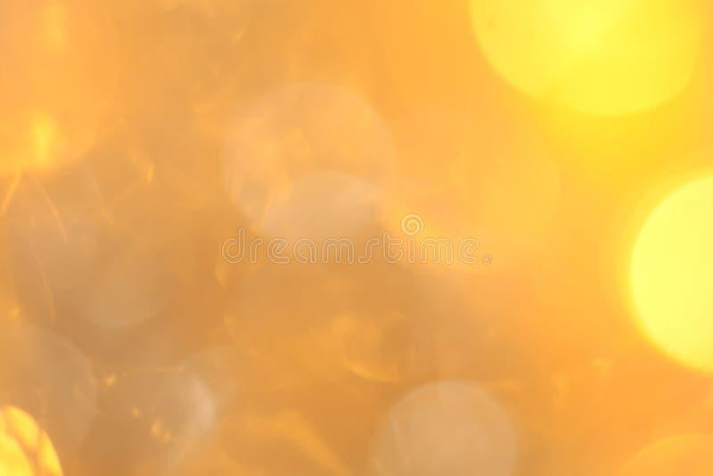 Fondo abstracto del bokeh de la Navidad de oro del brillo Contexto borroso de las luces foto de archivo