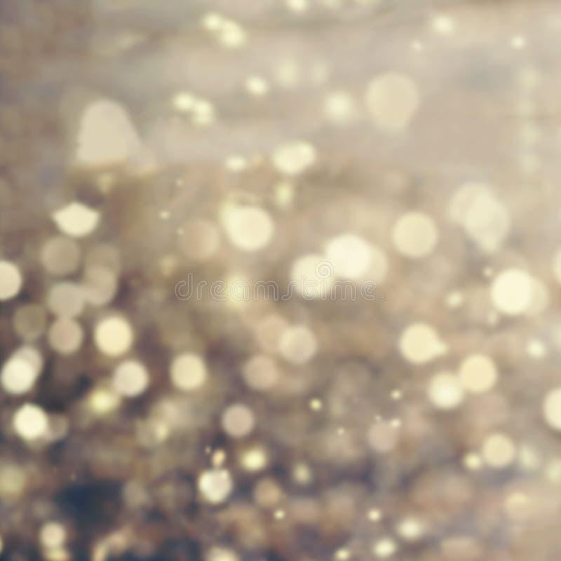 Fondo abstracto del bokeh del oro Luz Defocused del vintage del brillo imagen de archivo