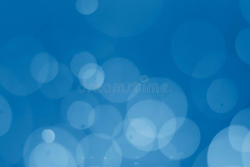 Fondo abstracto elegante azul con el bokeh ligero foto de archivo