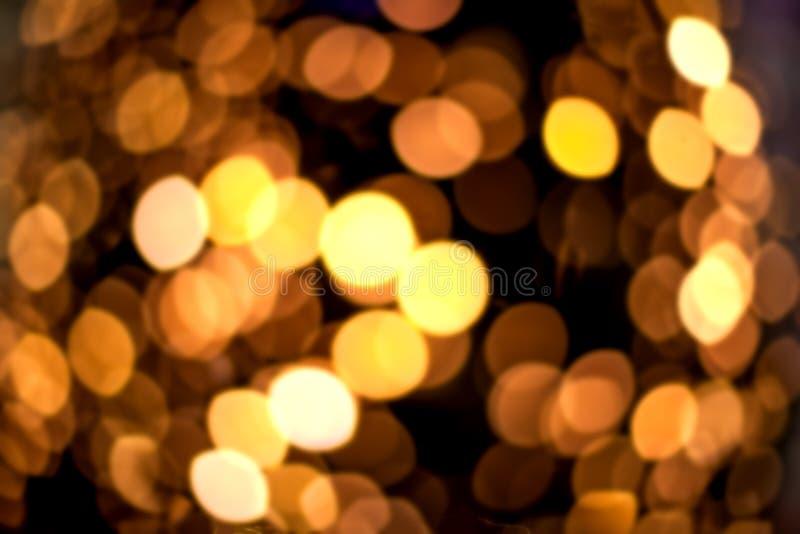 Fondo abstracto festivo de oro con las luces defocused a del bokeh foto de archivo libre de regalías