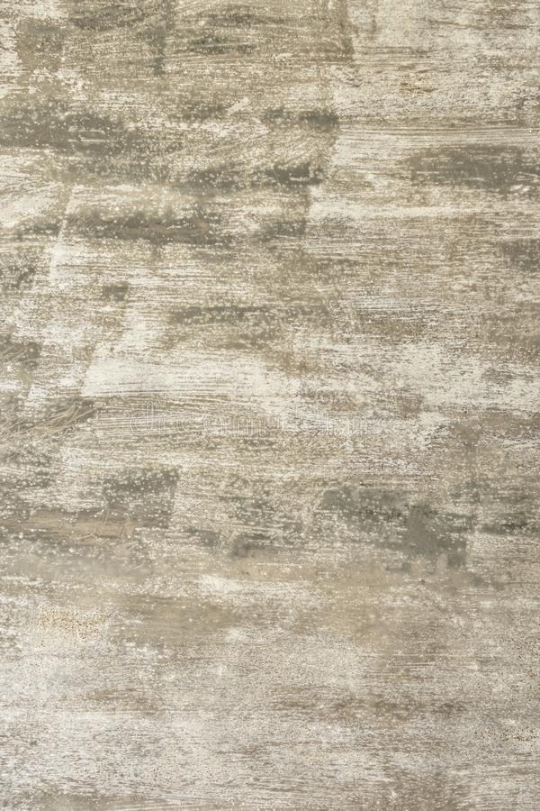 Fondo abstracto gris Pared cubierta con una capa desigual de pintura, de manchas y de rasguños Base para la disposición fotos de archivo