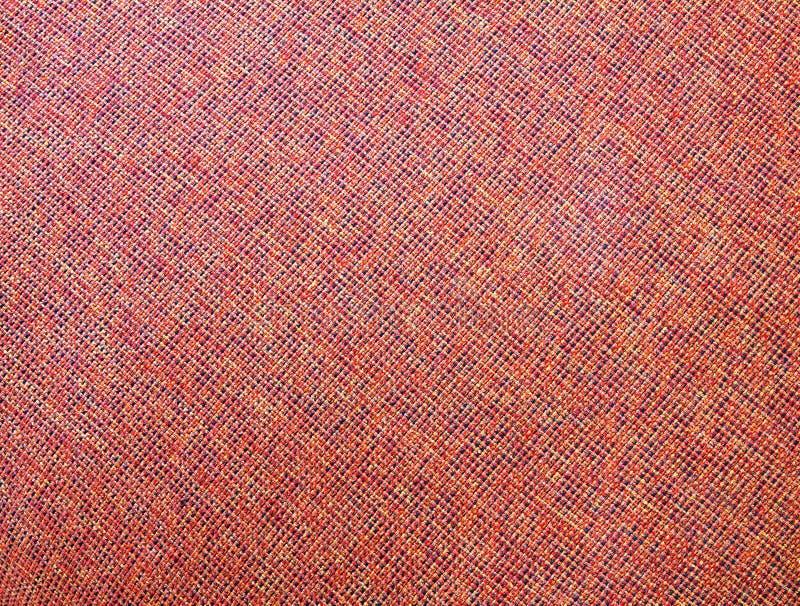 fondo abstracto mezclado Rojo-anaranjado de la textura de la tela fotografía de archivo