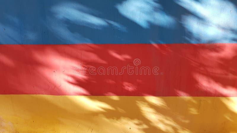 Fondo abstracto rayado de tres colores vibrantes imagen de archivo