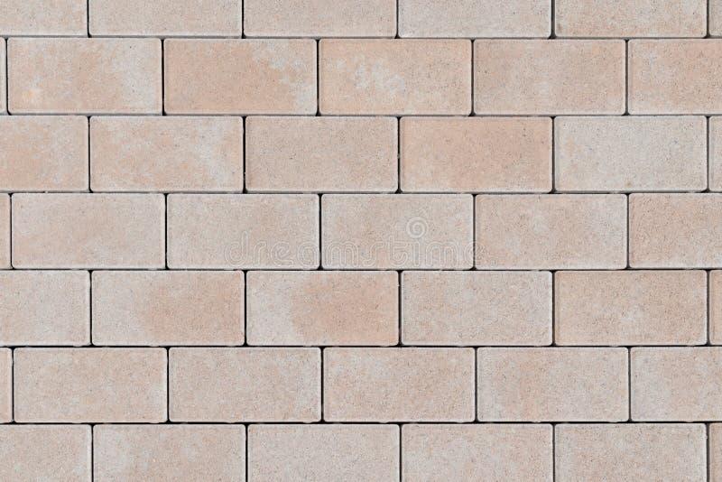 Fondo abstracto texturizado de la textura del ladrillo de la pared de piedra de la fachada de la piedra arenisca para el papel pi imagen de archivo