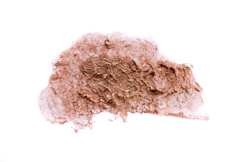 Fondo aislado color crema del polvo de la mancha de la bb-crema de la fundación del maquillaje foto de archivo