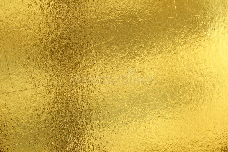 Fondo amarillo brillante de la textura de la hoja de oro de la hoja imagenes de archivo