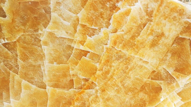 Fondo amarillo claro de la textura de mármol de ónix o de la textura del mármol del tono del color de la miel foto de archivo libre de regalías