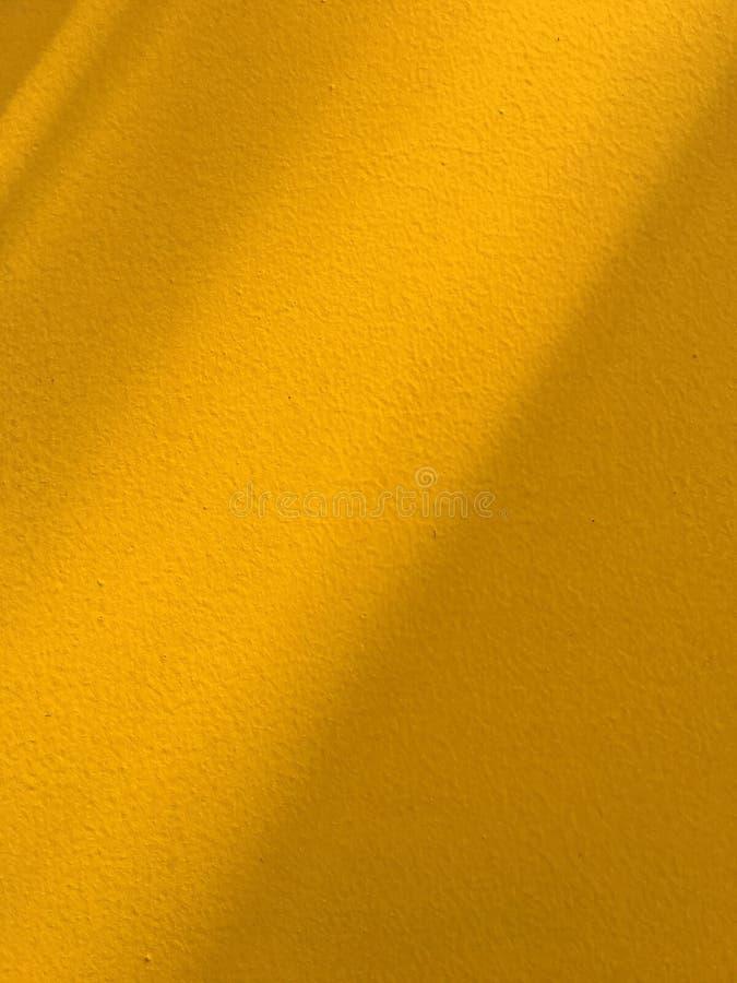 Fondo amarillo de la pared fotografía de archivo libre de regalías