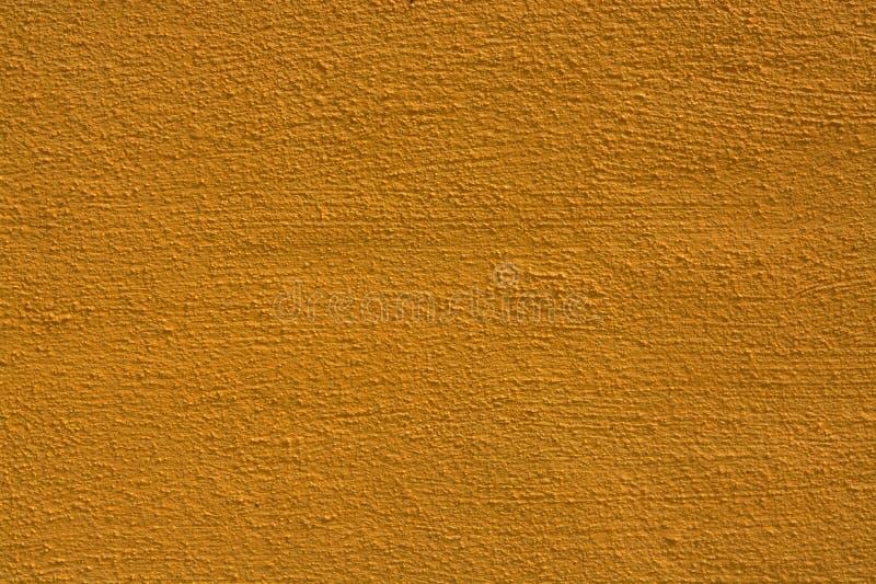 Fondo amarillo de la textura de la pared fotos de archivo