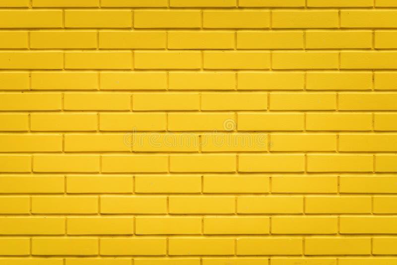 Fondo amarillo de la textura de la pared de ladrillo, modelo horizontal foto de archivo