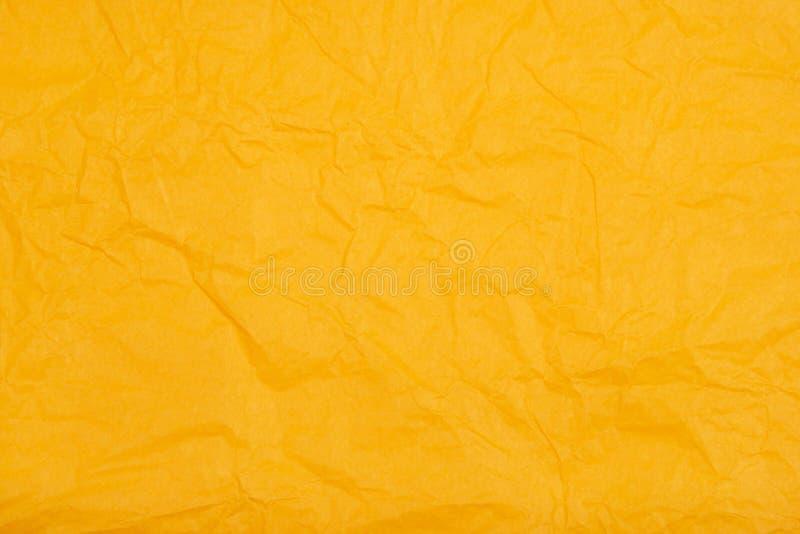Fondo amarillo de papel texturizado extracto del color imágenes de archivo libres de regalías