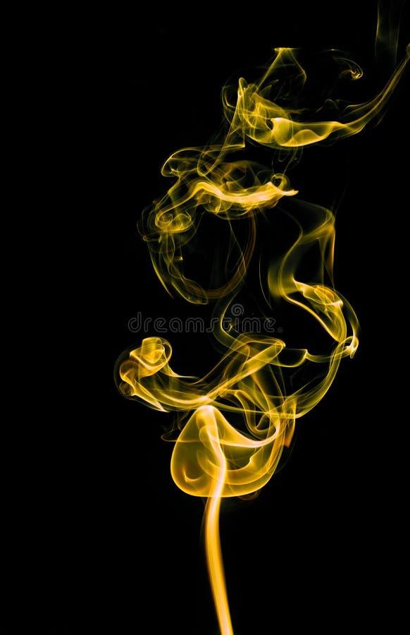 Fondo amarillo del extracto del humo fotografía de archivo libre de regalías
