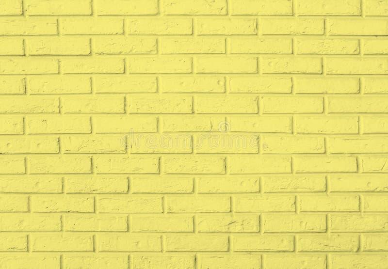 Fondo amarillo del modelo de la pared de ladrillo foto de archivo