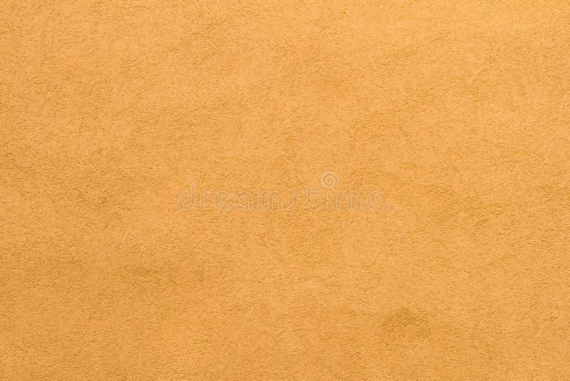 Fondo amarillo oscuro pálido de la textura de la pared del estuco imagen de archivo libre de regalías