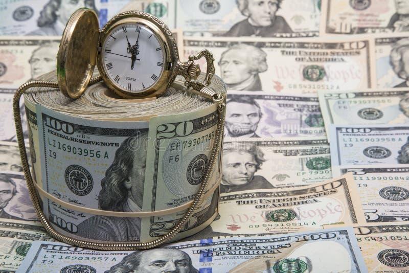 Fondo americano del reloj de oro del dinero imagen de archivo libre de regalías