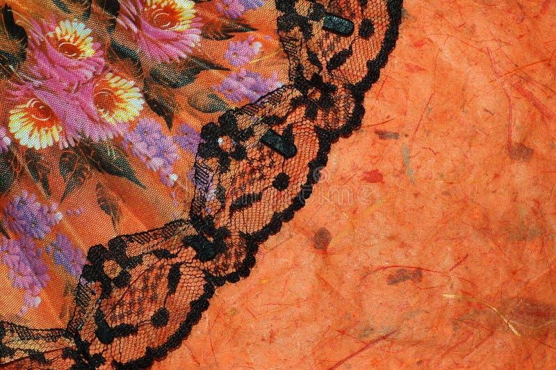 Fondo anaranjado con un ventilador español fotos de archivo