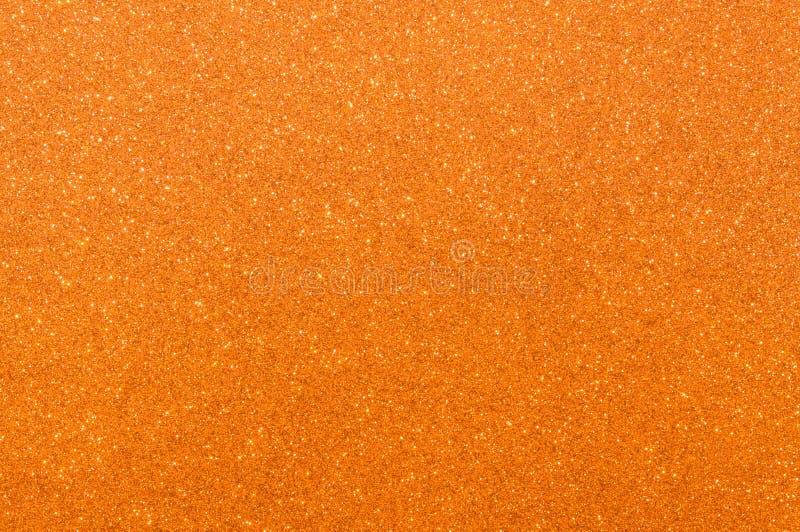 Fondo anaranjado de la textura del brillo fotos de archivo