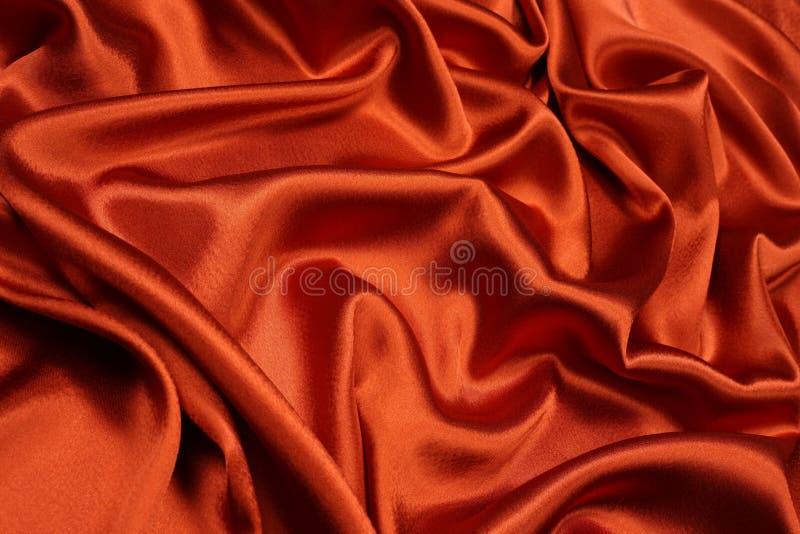 Fondo anaranjado del satén fotos de archivo libres de regalías