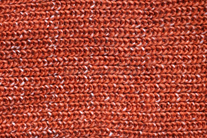Fondo anaranjado grueso de la tela del suéter del tejido en cable foto de archivo libre de regalías